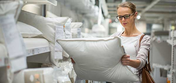 the woman chooses a pillow