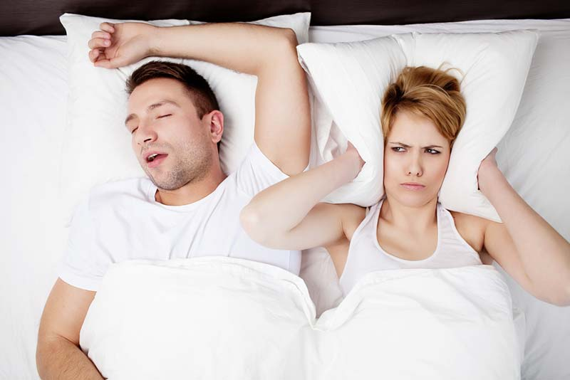 Snoring man and young woman