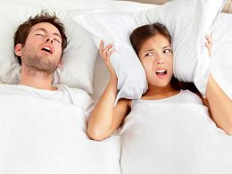 can't fall asleep as her husband snores loudly